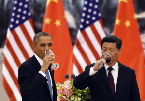 U.S. President Barack Obama and Chinese President Xi Jinping have a drink after a toast at a lunch banquet in the Great Hall of the People in Beijing