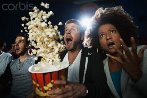 Audience at a scary movie --- Image by © Daniel Koebe/Corbis