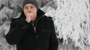 stock-footage-man-walking-coughing-symptoms-sickness-winter-concept