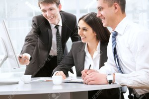 13622937-Happy-young-business-people-working-together-Stock-Photo