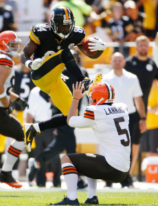PITTSBURGH, PA - SEPTEMBER 7: Antonio Brown #84 of the Pittsburgh Steelers attempts to hurdle Spencer Lanning #5 of the Cleveland Browns and gets an unnecessary roughness penalty during the second quarter at Heinz Field on September 7, 2014 in Pittsburgh, Pennsylvania. (Photo by Gregory Shamus/Getty Images)