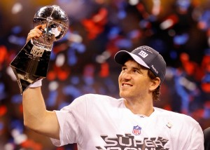 INDIANAPOLIS, IN - FEBRUARY 05: Quarterback Eli Manning #10 of the New York Giants poses with the Vince Lombardi Trophy after the Giants defeated the Patriots by a score of 21-17 in Super Bowl XLVI at Lucas Oil Stadium on February 5, 2012 in Indianapolis, Indiana. (Photo by Rob Carr/Getty Images)