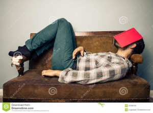 man-sleeping-old-sofa-book-covering-his-face-young-33408132