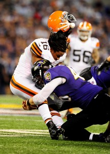 September 27, 2012;Baltimore, MD, USA; Cleveland Browns wide receiver Josh Cribbs (16) gets his helmet knocked off by Baltimore Ravens long snapper Morgan Cox (46) at M&T Bank Stadium. Mandatory Credit: Evan Habeeb-US PRESSWIRE