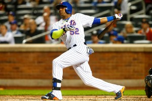 NEW YORK, NY - SEPTEMBER 14: Yoenis Cespedes #52 of the New York Mets hits a third-inning home run against the Miami Marlins at Citi Field on September 14, 2015 in the Flushing neighborhood of the Queens borough of New York City. (Photo by Jim McIsaac/Getty Images)
