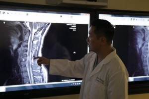 Dr. Lui, the head of the research team, showing the patient's spinal cord injury.