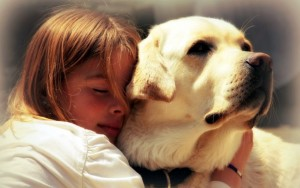 13250619-lovely-little-girl-hugging-pet-dog-with-passion-eyes-closed-1024x640