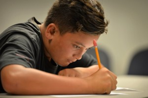 Benjamin Torrevillas, 13, writes down what he learned during a marijuana support class focusing on health effects at the Juvenile Justice Center in Garden Grove. Photo by Steven Georges/Behind the Badge OC