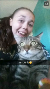 Sarah and one of our cats Groot *picture was taken by my sister on snapchat and sent to me*