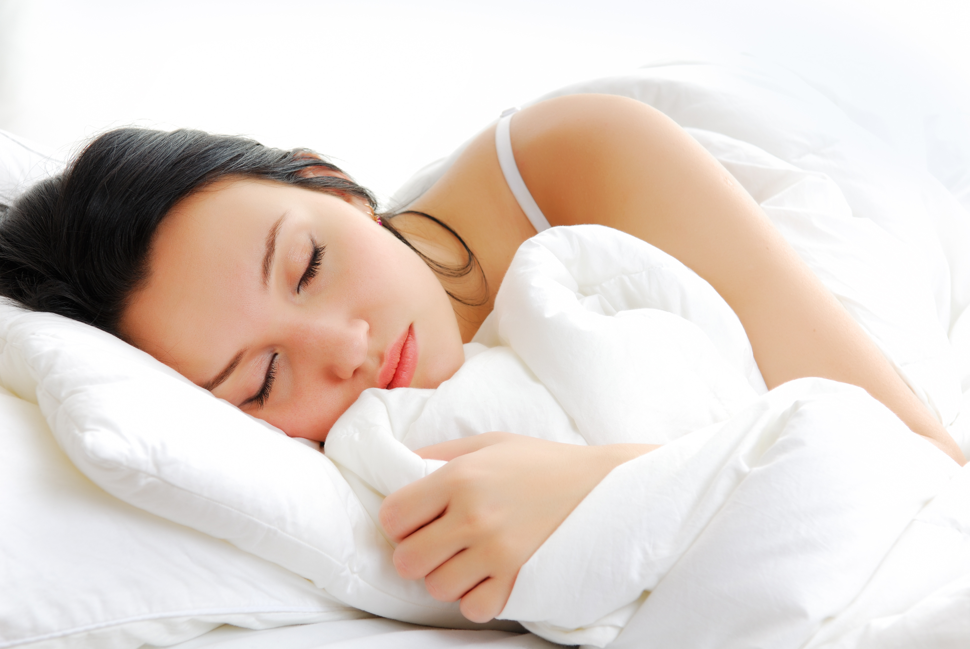 Beautiful woman lying and sleep on the snowy bed. How to Get More Sleep at College   SiOWfa16  Science in Our World