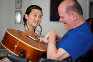 This photo was made at the man's home, where he was participating in a music session with a staff member.