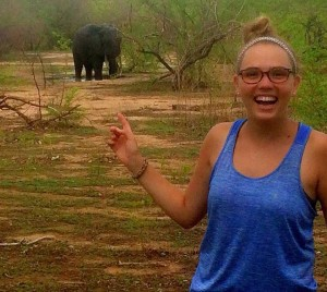 Emily Shearer pointing at an elephant