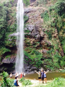 Emily Shearer and friends posing in front if a waterfall