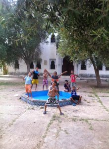 Children in Morocco posing by a fountain