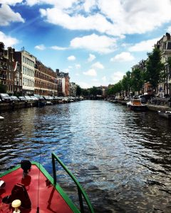 View of Amsterdam canal from a boat