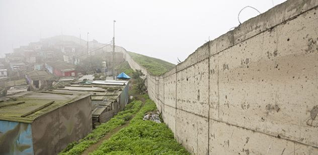 The approximately 6-mile wall, a response to a wave of migration in the 1980s, now divides the Peruvian capital's rich neighborhoods from its poor ones.