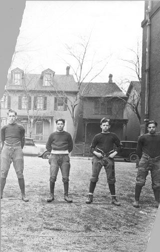 Four Football Players in Uniform