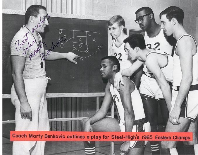 Marty Benkovic Outlines a Play for Basketball Team, 1965