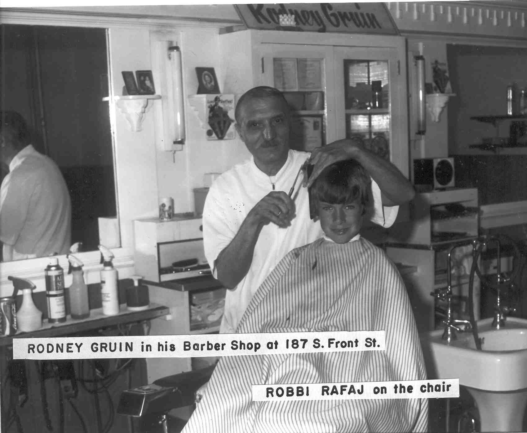 Rodney Gruin in his Barber shop, 187 S. Front Street