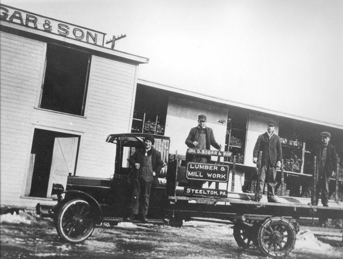Three Bogar Employees with New Delivery Truck and Driver, 201 Franklin Street